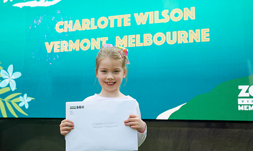 Charlotte Wilson holding an envelope, smiling for camera